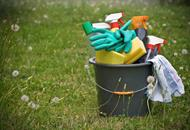 Bucket full of cleaning products in field