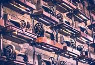 Image of sewing machines lined up on a factory wall