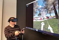 Cardno employee showing virtual reality (VR) project work