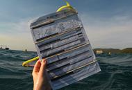 Photo of reef check clipboard in the waters off Orpheus Island