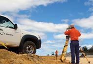 Surveyor and Cardno truck on worksite