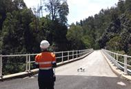 RPA pilot and a remotely piloted aircraft on a bridge