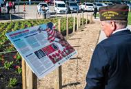 War veteran looking at display at the Ohio Department of Transportation's World War I Red Poppy Remembrance Garden